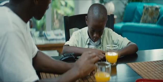 Moonlight: Little and Juan talk at dining room table