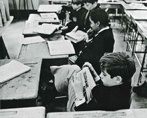 School boys reading a textbook